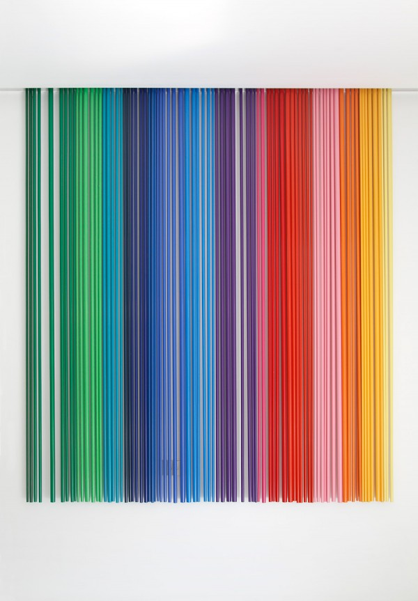 The multi-coloured art installation, comprising a series of powder coated steel poles, where the different gauges and tonal shades make the simple into the extraordinary. Placed next to a doorway, the movement from the wind activates this unique art piece.
